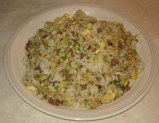 Ground Beef Fried Rice... this is my favorite way of making fried rice, except I typically use cabbage and peas instead of lettuce the recipe calls for.