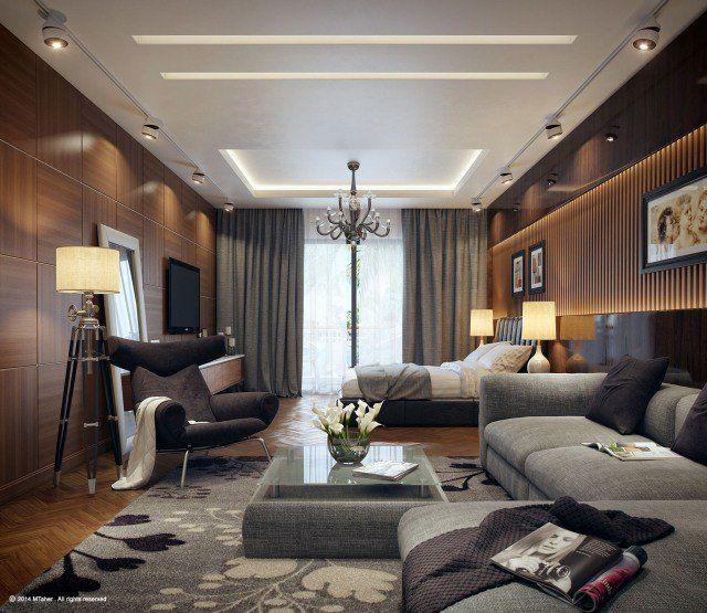 chambre adulte design avec panneau mural en bois, lampadaire tripode, tapis et canapé en gris