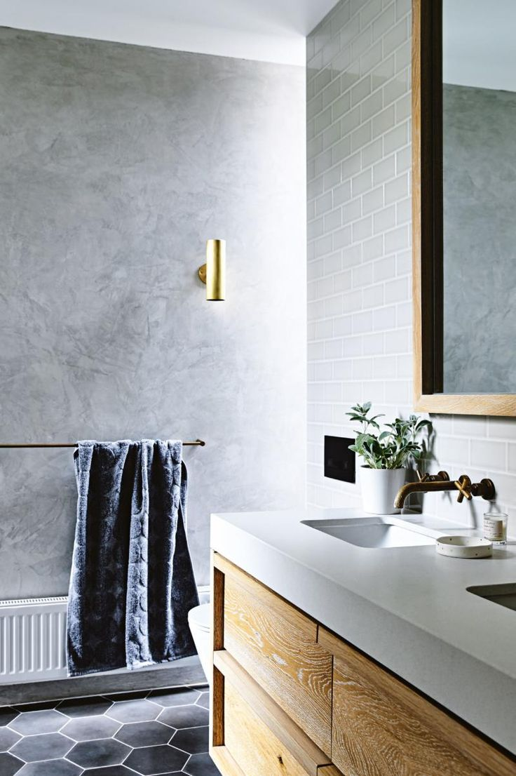 """The tapware throughout the home is from Astra Walker. The Stone Italiana benchtop is """"super durable and practical,"""" says Anthea. """"Just wash and wipe down."""" Both the floor and wall tiles are from Bespoke Tile & Stone Photographer: Derek Swalwell Stylist: Rachel Vigor Inside Out Magazine"""
