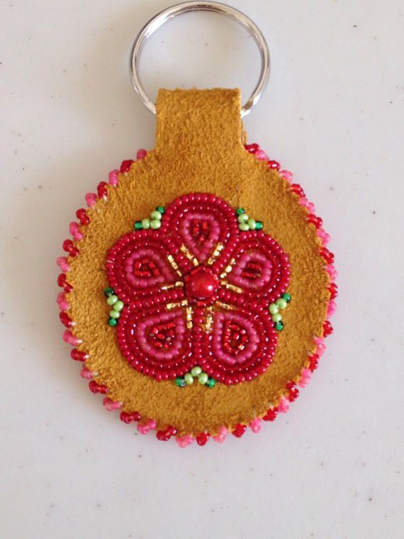Check out this item in my Etsy shop https://www.etsy.com/listing/541771763/athabascan-flower-keychain