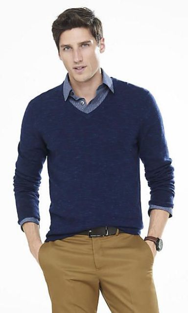 yellow trousers, a navy sweater and a blue shirt