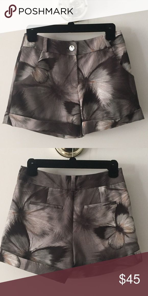 Ted Baker butterfly print shorts Ted Baker butterfly print shorts. Size 0. Beautiful luxurious fabric. Purchased from Bloomingdales for $150. Worn once or twice. Ted Baker Shorts