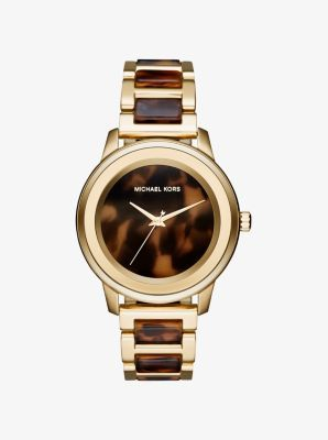 Exclusively Ours in Michael Kors stores and on michaelkors.com until 7/30/16.  It's always time to shine with our Kinley watch. A numberless dial, tortoise acetate accents and a glamorous gold-tone stainless steel setting combine for a statement rich in radiance and refinement.