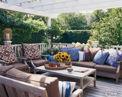 outdoor lounge with comfy cushions on the deck