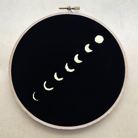 The phases of the moon are embroidered by me with 100% cotton black fabric and a light yellow embroidery floss into a 6 wooden embroidery hoop.