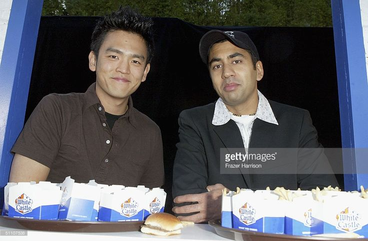 Actor Kal Penn (R) poses with Actor John Cho at the 'Harold And Kumar Open A White Castle Restaraunt' event to promote the forthcoming New Line Cinema release of the comedy 'Harold and Kumar go to White Castle' held on the Sunset Strip on July 22, 2004 in Hollywood, California.
