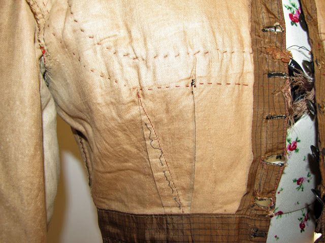 inside front edge on 1860s silk bodice