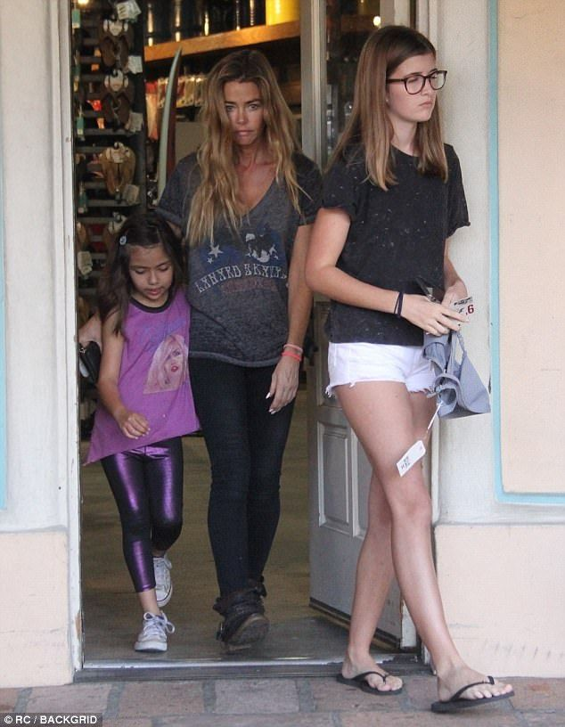 Mommy day: Denise Richards, 46, has turned in her spy girl role for doting mother as she w...
