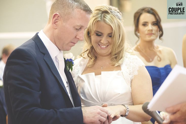 The bride & groom exchange wedding rings. Weddings at The Heritage Hotel by Couple Photography.