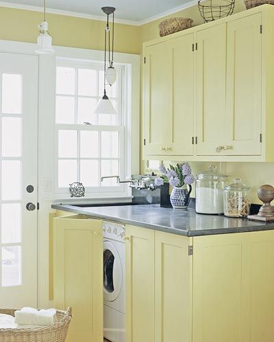 This laundry room makes me want to use more yellow in my house. So pretty.