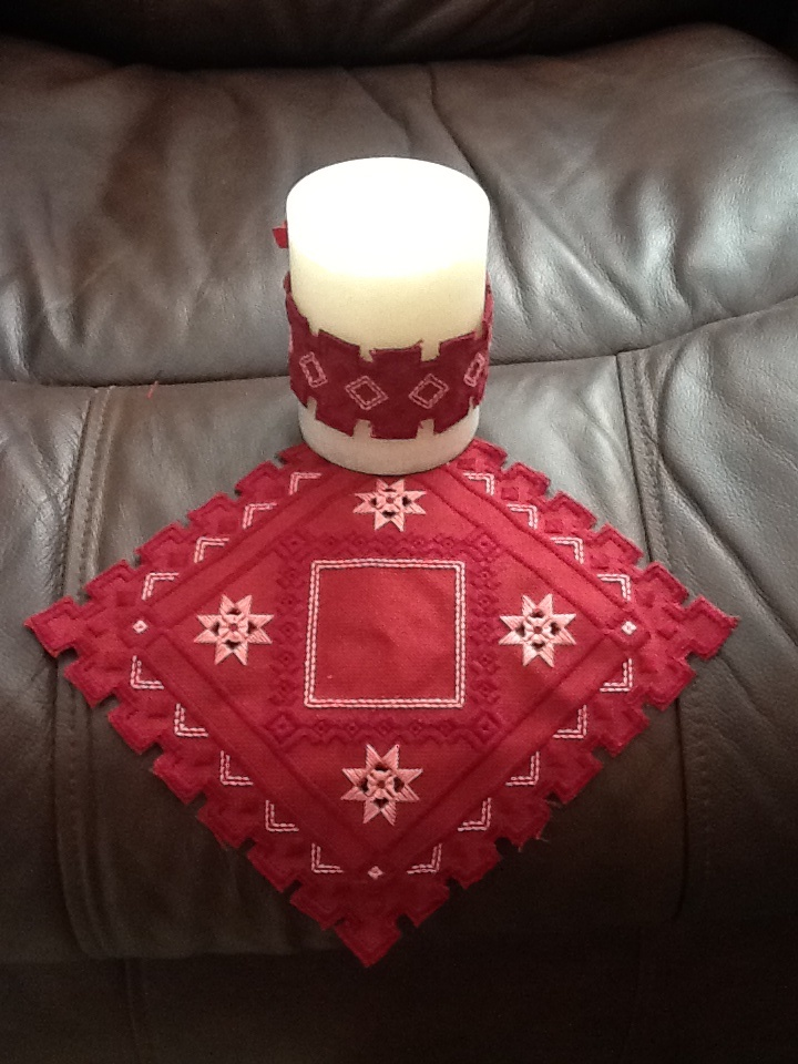 I made this Hardanger candle for my mother for Christmas. She has lots of red accent in her home, so this color scheme will look nice. (My sister made this. )