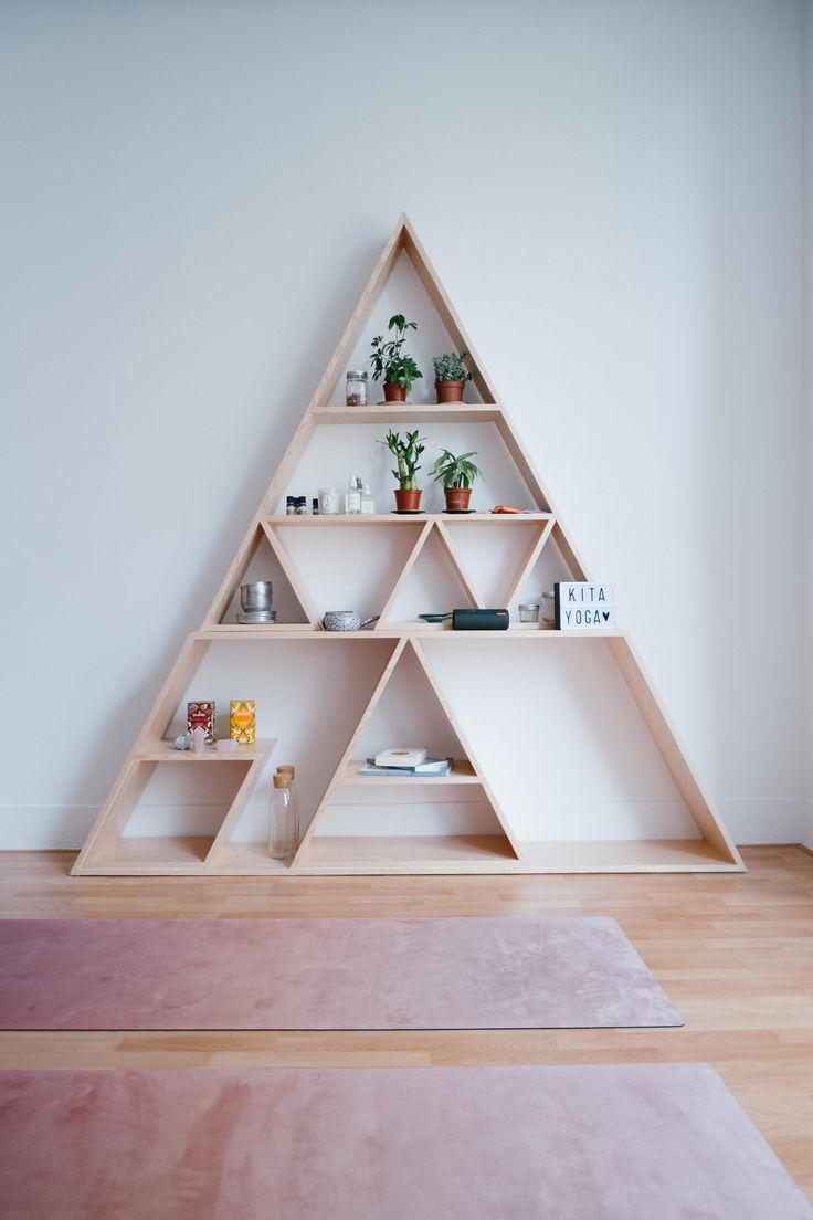 Triangle shelves in a pretty yoga studio