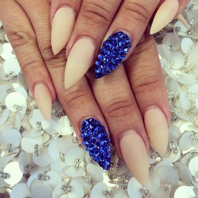 Matte natural shade. Blue jewel junk nail.