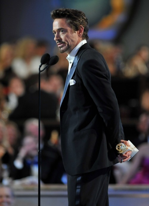"Robert Downey Jr. accepting his Golden Globe Award for Best Actor (""Sherlock Holmes"")"