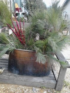 Many Outdoor Containers, like this vitage Copper Boiler, Filled With Winter Greens, Berries & Pine Cones at Gold'n Country Gifts llc, Facebook, WI