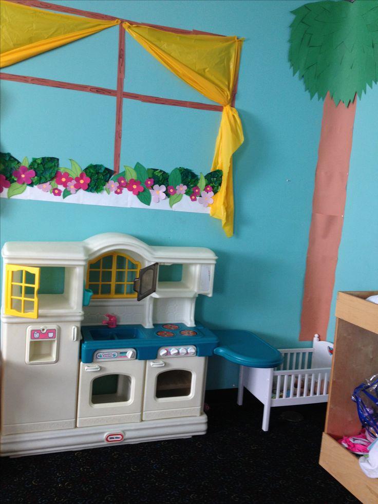 Preschool classroom creative dramatic play dress up house area