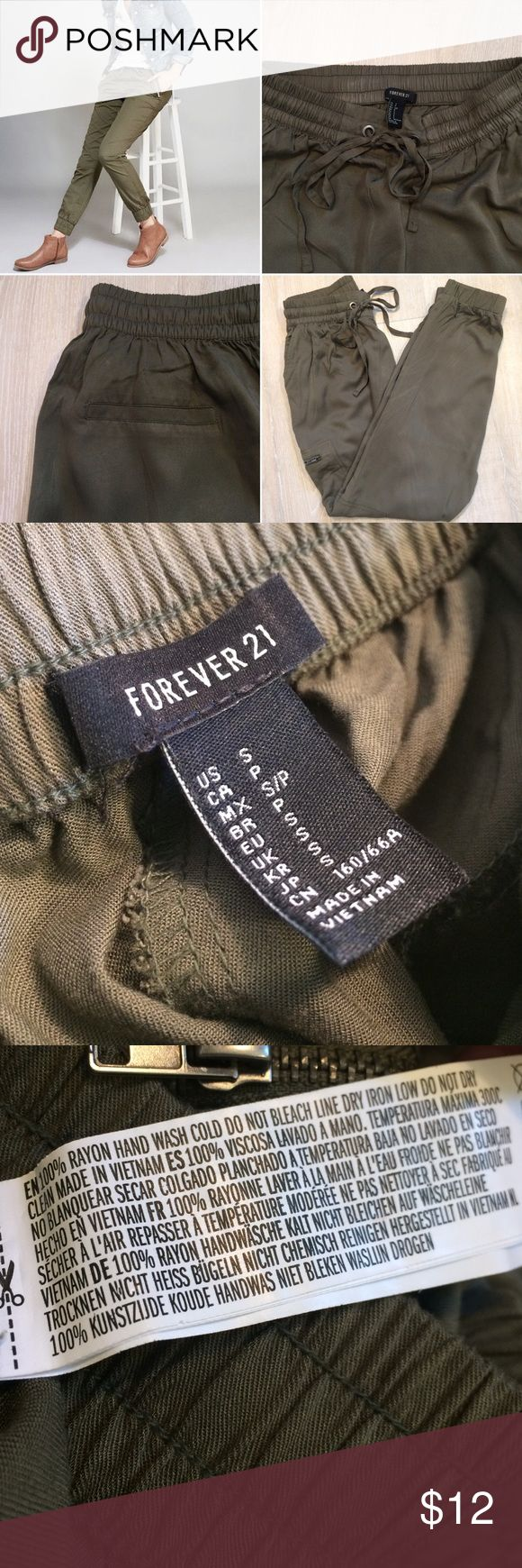 F21 Olive Green Joggers With Zipper Pockets Size women's small (2-4) | Features: elasticized waist drawstring, elasticized ankles, double hand pockets, double zippered leg pockets, illusional back pockets | Great condition, hardly worn | PRICE FIRM - Bundle for discounts (: Forever 21 Pants Track Pants & Joggers