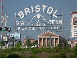 Bristol, Tennessee!  Bristol, VA--TN on one side of State St. (main street)  and TN on the other lane. Borders 2 states.  Great place to live! Home of Bristol Motor Speedway.