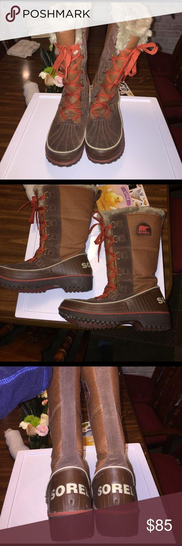 Sorel tivoli boots sz 9 Sorel Tivoli tall boots. Worn twice! Browns and a reddish orange lace. GORGEOUS snow boots! Size 9 women's Sorel Shoes Winter & Rain Boots