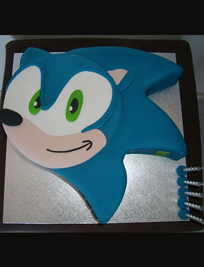 Chocolate mudcake carved and then covered in fondant to capture the bright colours and mischievous grin of Sonic the Hedgehog.