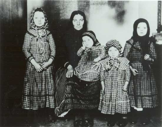 Hungarian mother and daughters specially dressed for their arrival in America.