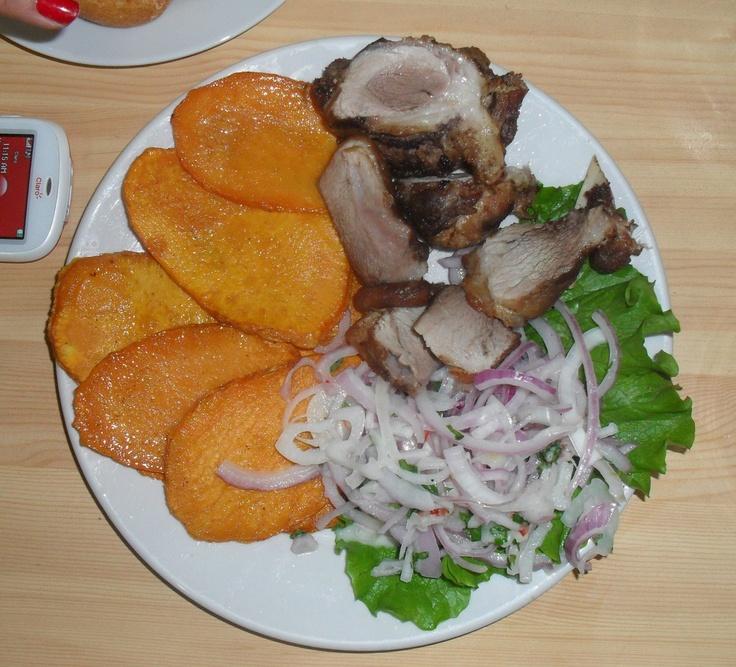 Chicharrón con camote y sarsa. Tipico desayuno peruano. # ...