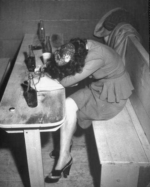 Lady feeling the effects of too much liquor. Kansas, 1946.   Too much liquor *scoff*