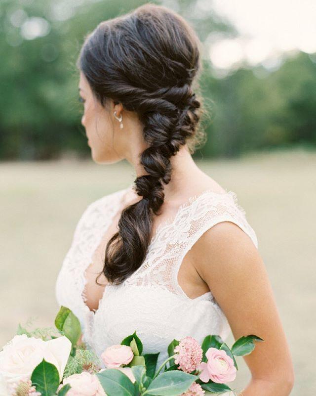 This twisted #chignon #bridal #braid is perfection! #weddinghair #hairinspiration | Photography: @tenthandgrace | Calligraphy: @seniman_calligraphy | Floral Design: @everlyalaineflorals | Hair + Makeup: @tracymeltonartistry | Wedding Dress: @patsysbridalboutique | Styling: @lindseyzamora