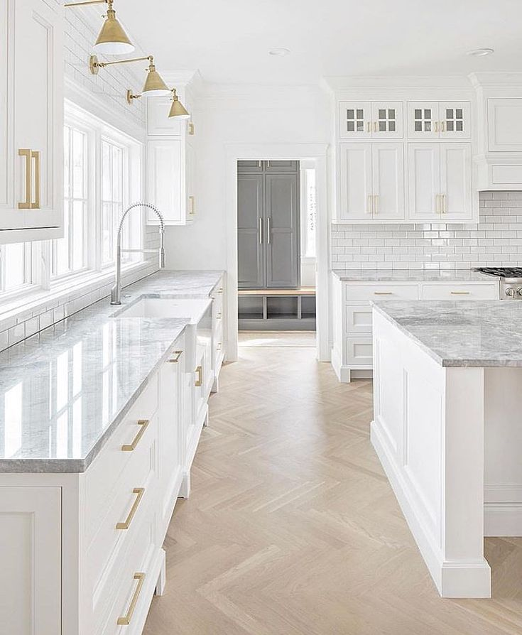 Light Wood Floors, White Cabinets & Grey Laundry Room To