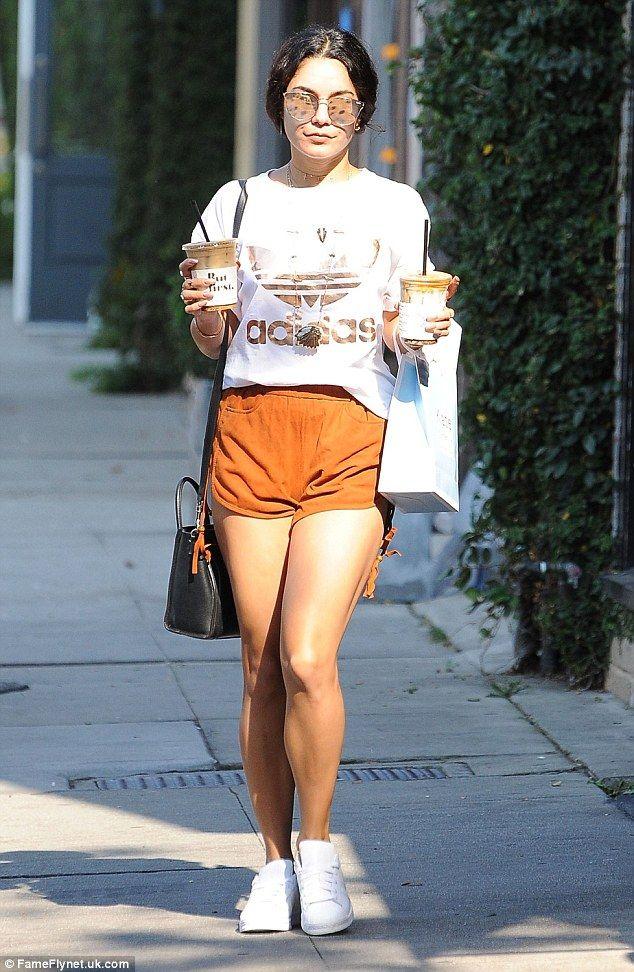 Sporty look: Actress Vanessa Hudgens showed off her toned legs in orange shorts…