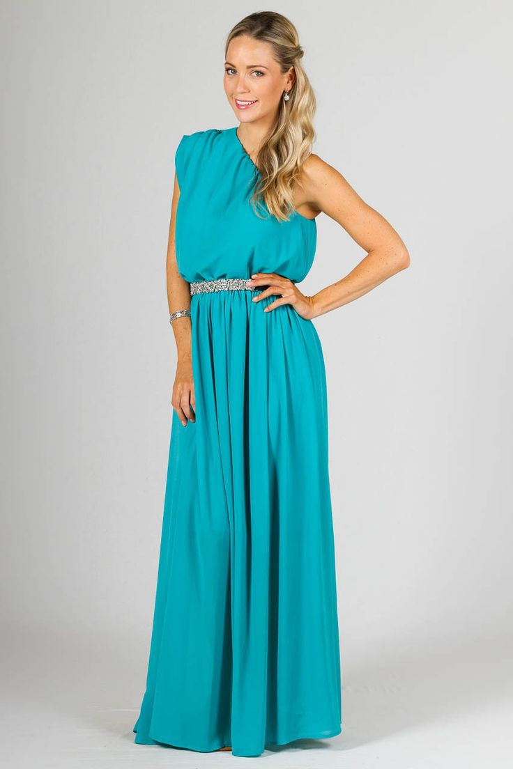 """Ella Maxi Dress - Aqua - Paper Scissors Frock bridesmaids dress. A gorgeous one shoulder designed maxi dress which looks elegant belted for a dressy look or unbelted for a more casual look.  This frock really can be dressed up or down.  With a double layered full chiffon skirt, elasticised at waist and a gathered feature on the little cap sleeve.  Made from Chiffon.  *belt not included model's own.  Pictured model 5'8"""""""
