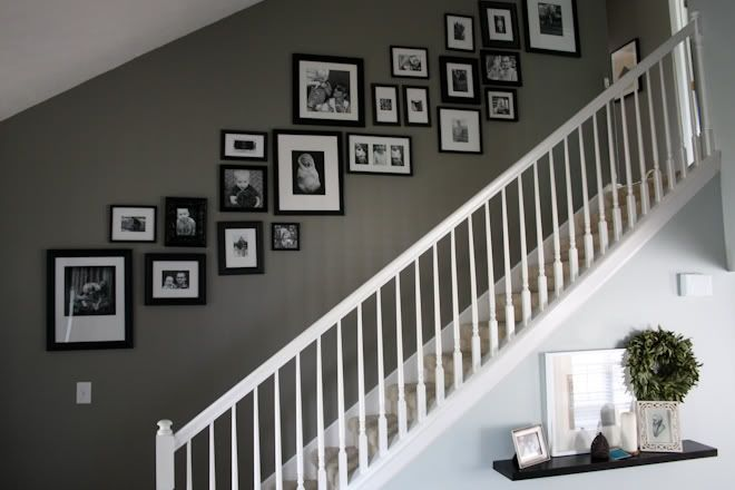 Love the layout, black frames, black and white photos, and that color gray on the walls! @raechelmyers