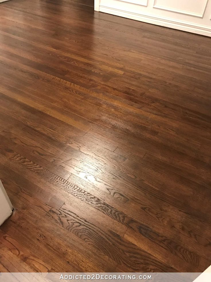 refinishing red oak hardwood floors - adding stain to first coat of polyurethane to darken the color - music room