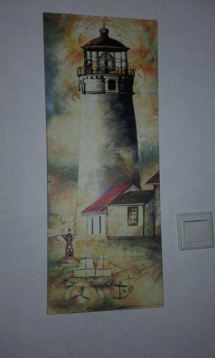 19. Dit is een schilderij die in de woonkamer hangt en ik weet niet wie het gemaakt heeft maar er staat een vuurtoren op afgebeeld.