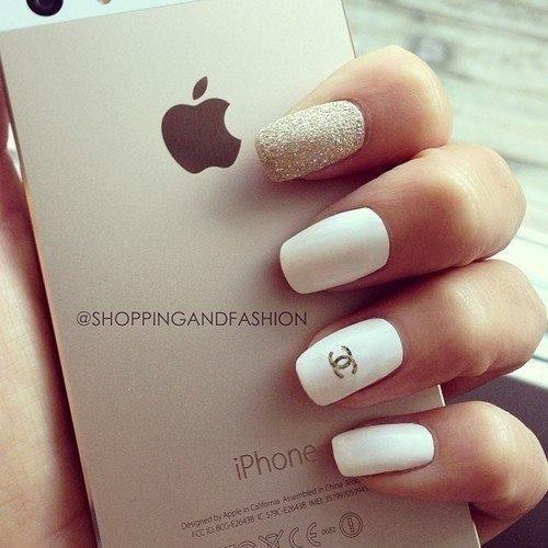 matte white nails and shiny golden sparkles