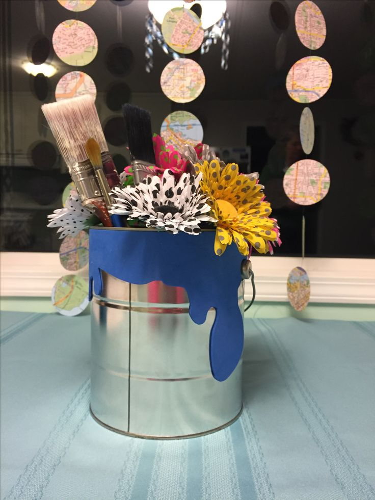 Paint can flower vase with paint spilling over (including paint brushes)