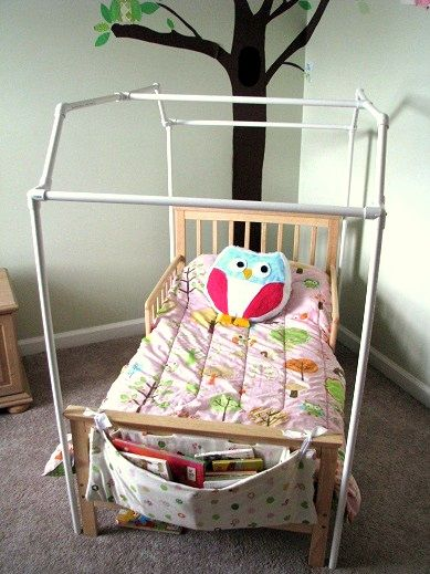 DIY Canopy bed...Love the idea, plus the fabric she used for the canopy is what C's curtains are made from, wish I had more of it now!!
