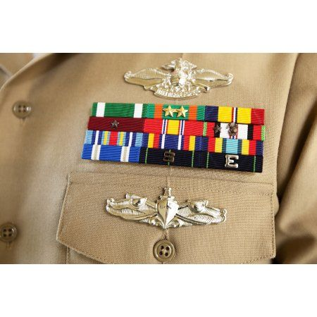 close up view of military decorations and honors on the uniform of a petty officer - Military Decorations