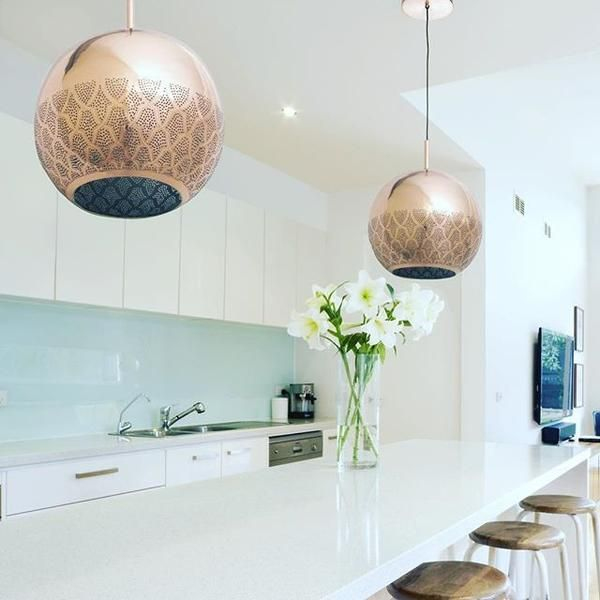 Modern Moroccan copper pendants lighting adds warmth to this lovely kitchen! We love the look of copper pendant lights over a kitchen island • UL-listed •  handcrafted in Morocco •