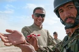 "An Afghan National Army soldier writes the Dari characters for ""Obama"" on the palm of Spc. Denzell Ward, an infantryman with the 82nd Airborne Division's 1st Brigade Combat Team, May 8, 2012, Ghazni province, Afghanistan. Ward says the Afghan soldier is not the first to compare his looks to that of the United States' 44th president.    Read more: http://www.dvidshub.net/news/88376/guess-really-do-look-like-obama#ixzz1v6Ux1DxL"