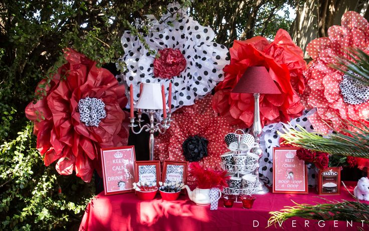 Red, Black and White themed garden birthday party buffet table tea and coffee station with Betty Boop decor accents and giant paper flowers