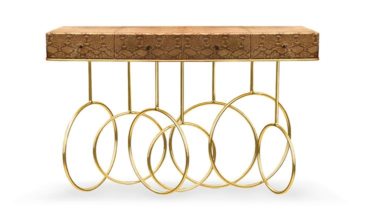 Burlesque console by KOKET | Revisit the dazzling world of a French cabaret through the Burlesque console. Its acrobatic polished brass loops & spins paired with black exotic skins and a black crystal on each one of the 4 drawers exude the mysterious traits of a feisty diva. #console #luxurydesign #interiordesign http://www.bykoket.com/guilty-pleasures/casegoods/burlesque-console.php