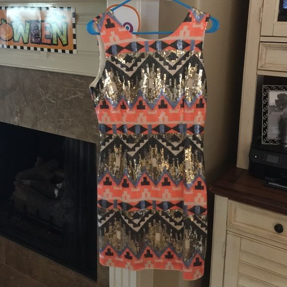 ESLEY Aztec Dress NWT Sequin Esley Aztec short dress size Medium... This style was sold out at all Louisiana Boutiques. I had to find it at a boutique out of state and ended up not wearing it due to needing the larger size. Esley Dresses