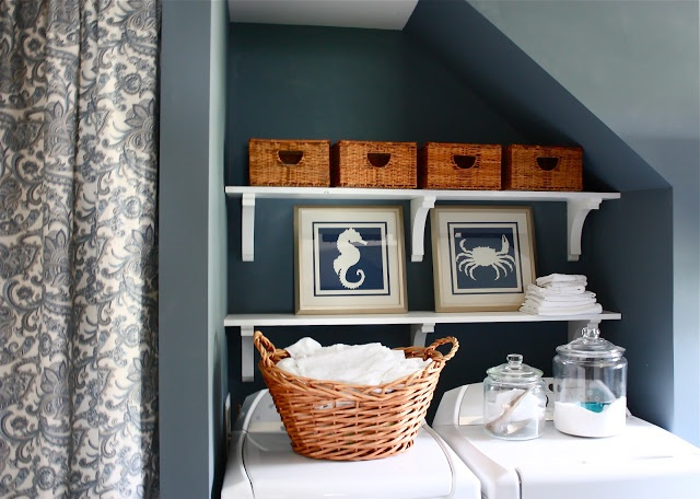 Need to do something with our laundry room. Love the color and shelves!