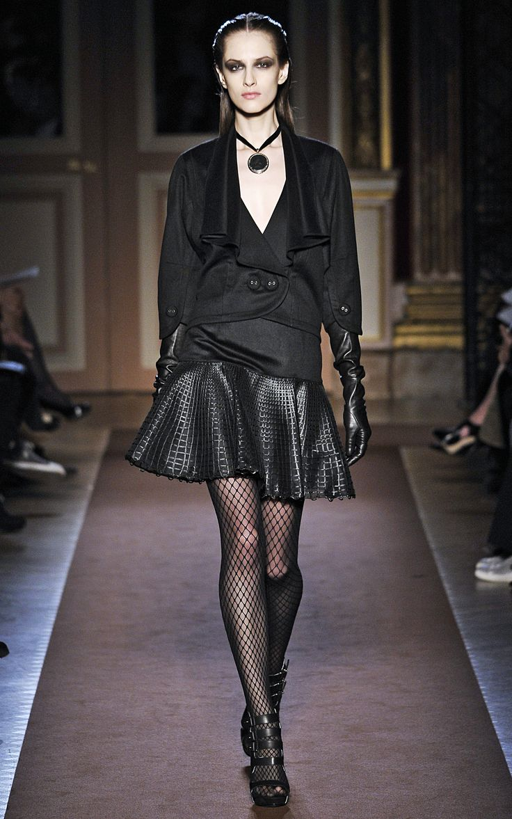 Andrew Gn Autumn Winter 2012-2013 Black cashmere cocoon jacket with bracelet sleeves, leather embroidered godet skirt.