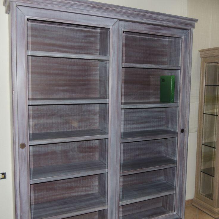Mobile-libreria (240x260) in listellare di legno massello con ante scorrevoli in legno massello di meranti, cornice con vetri in cristallo bisellato