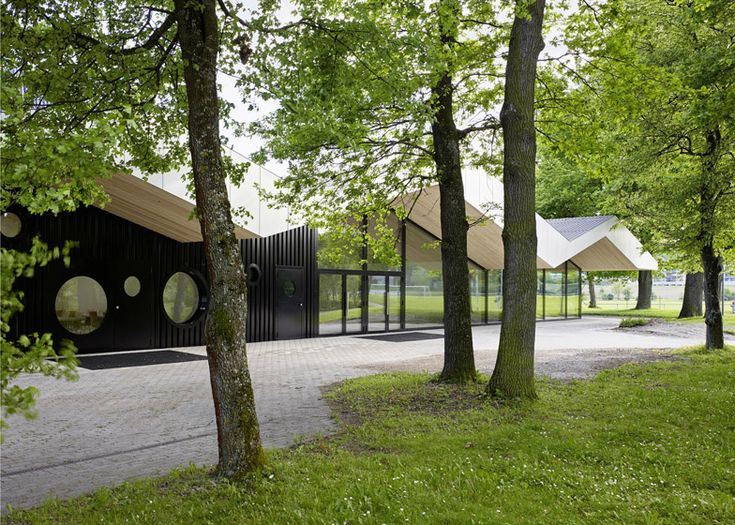 Frei + Saarinen adds a zigzagging roof to a community centre extension