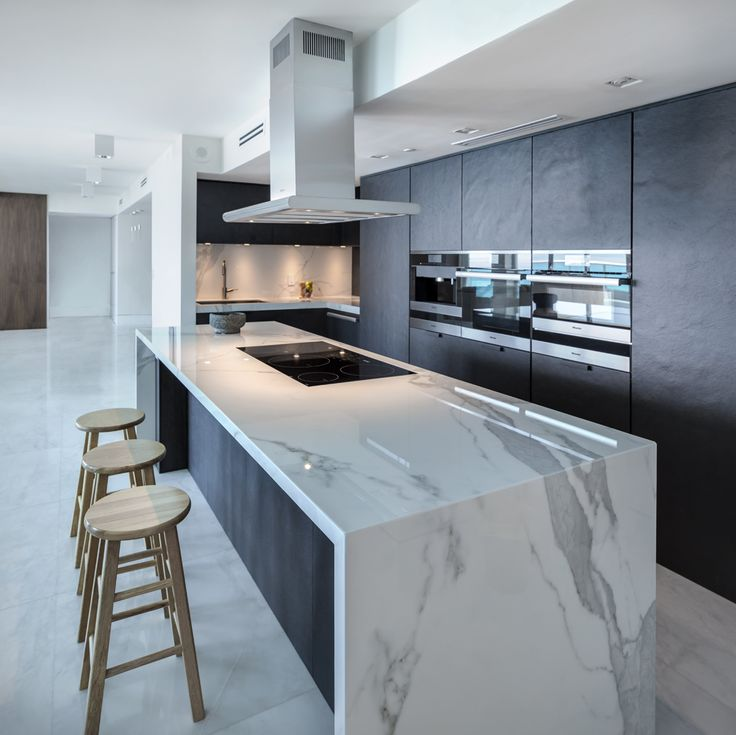 #Neolith, the main material in a luxurious apartment in Miami Beach. Neolith #Estatuario Polished in kitchen #countertop, island and #backsplash.