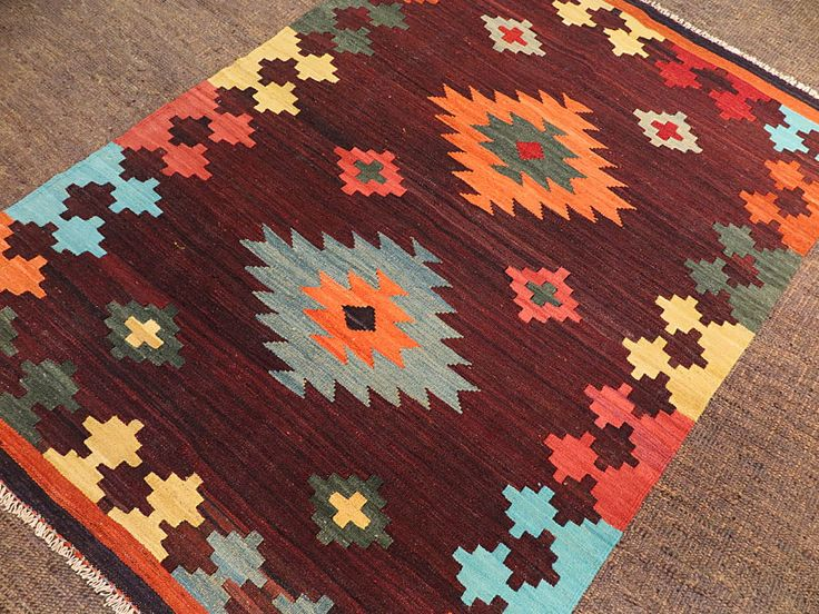 This handmade kilim rug is flat woven in a tapestry weave technique. Made with all natural dyes and handspun wool. These kilims have a slightly rough primitive texture and a rich abrash. This makes them look much like the antique kilims prized by collectors. The designs are primarily sourced from Persian tribal flat weaves. The…