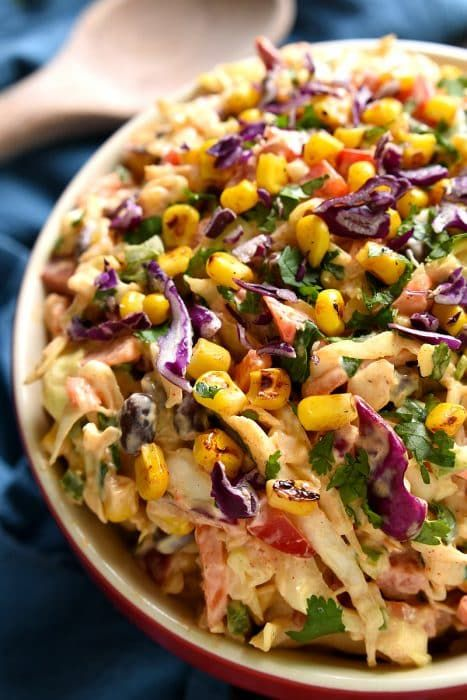 1 (14 oz.) bag coleslaw mix ½ c. red pepper, diced ½ c. black beens, rinsed and drained ½ c. grilled corn ½ c. minced cilantro 1 jalapeno, seeds removed and finely diced ¾ c. mayo ¼ c. sour cream ½ package taco seasoning 2 Tbsp. lime juice